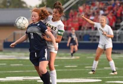 Bel Air's Allison Mace, left, plays the ball with her body in front of North Harford's Clare Cummings during a girls soccer game at Bel Air High School on Tuesday, Sept. 14, 2021.