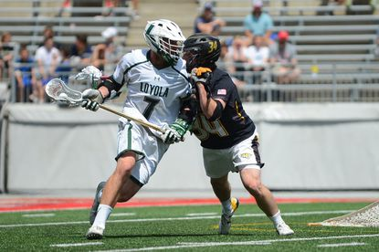 Loyola freshman Pat Spencer, left, shown driving on Towson's Pat Conroy, led the Greyhounds with 36 goals and 47 assists.