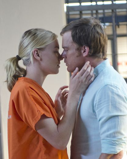 Hannah and Dexter lean in close for the kill -- I mean, kiss, in the season seven finale. She's in jail, by the way.