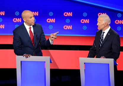 New Jersey Sen. Cory Booker, left, points at former Vice President Joe Biden during Night 2 of the Democratic primary debate at the Fox Theatre in Detroit on Wednesday.