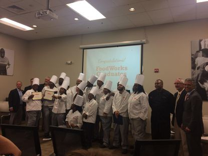 Culinary training program Food Works graduates assemble for a class picture.