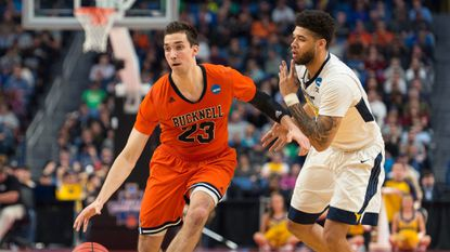 Bucknell's Zach Thomas carries the ball in the first round of the NCAA tournament against the West Virginia Mountaineers at The KeyBank Center on March 16, 2017 in Buffalo, New York.