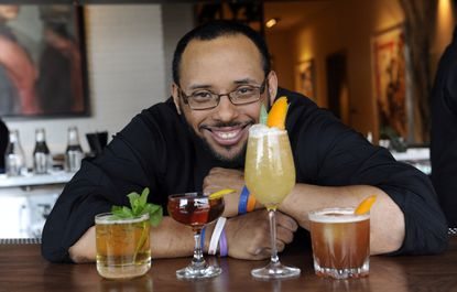 "Aaron Joseph, lead bartender at Wit and Wisdom in the Four Seasons Hotel, makes ""forgotten cocktails."" Left to right: Diamondback, Prekness Cocktail, Belvedere Frozen Rye, Farragut. Barbara Haddock Taylor/Baltimore Sun"