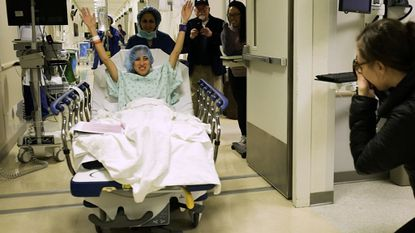In this image made from video provided by Johns Hopkins Medicine, Nina Martinez of Atlanta is wheeled into a Baltimore operating room to become who is thought to be the world's first kidney transplant living donor with HIV.