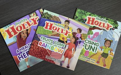 """In this March 2019 file photo, copies of then-Baltimore Mayor Catherine Pugh's self-published """"Healthy Holly"""" illustrated paperbacks for children are seen in Baltimore."""