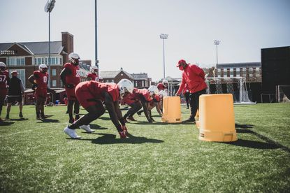 Maryland players prepare for a drill during the team's 2021 spring football practice.