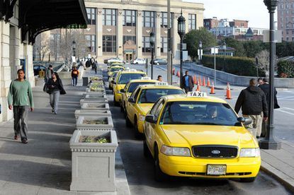 Taxis wait for customers outside of Penn Station.