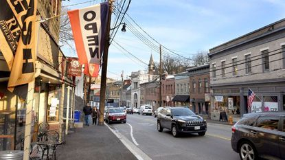 Main Street in Ellicott City is shown in March, 10 months after the deadly 2018 flood. Some business, such as Syriana Cafe, have reopened. Some new business have moved in, but several buildings remain unoccupied with businesses choosing not to return.
