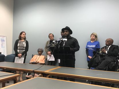 Tre' Murphy, field organizer for the ACLU of Maryland, speaks at a news conference calling for an independent investigation into the officer-involved fatal shooting of Eric Sopp in November.