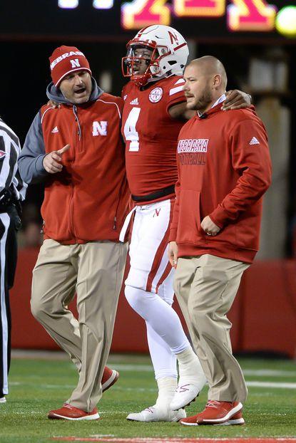 Nebraska quarterback Tommy Armstrong Jr. is helped off the field against Minnesota at Memorial Stadium on Nov. 12, 2016 in Lincoln, Nebraska.