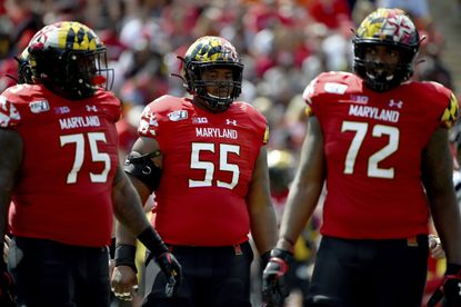 Maryland offensive lineman Terrance Davis (75), Austin Fontaine (55), and Marcus Minor (72) look on between plays against Syracuse on Saturday, Sept. 7, 2019, in College Park.