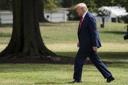 President Donald Trump arrives on the South Lawn of the White House in Washington on Sept. 26 as Democrats prepare to do an impeachment inquiry.