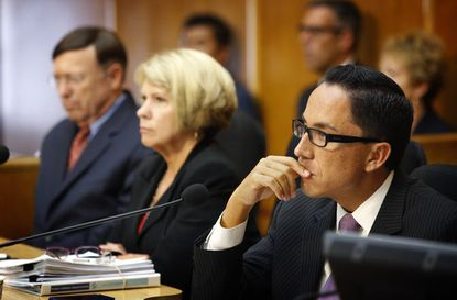 City Council President Todd Gloria, right, listens to public comment Friday before the council voted to accept a deal that includes Mayor Bob Filner's resignation. Gloria will serve as interim mayor until a replacement is elected.