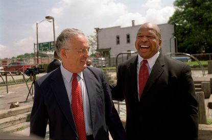 In 2002, Sen. Paul Sarbanes and Rep. Elijah Cummings shared a laugh after they announced a $1 million federal grant to seven Baltimore City elementary schools to fix up their playgrounds.