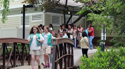 Jessup Girl Scouts from troops 963, 2389 and 476 participated in a ceremony for progressing to the next level of Scouting on May 30 in Odenton.