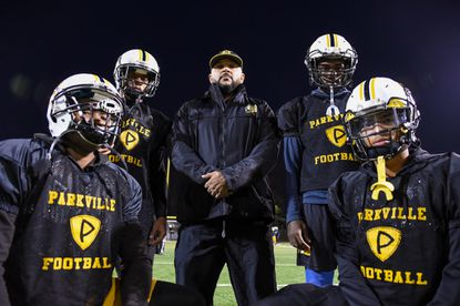 Clockwise, from bottom left: running back Arriq Redd, running back Noah Hambrick, head coach Justin Payne, quarterback Kevin Smith III, running back Da'Vaugh Curbeam. Parkville High School's undefeated football team runs a Navy triple-option offense coached by Justin Payne, who's been with the school for 5 years. Three running backs and and the team's quarterback all have 600+ yards this season.