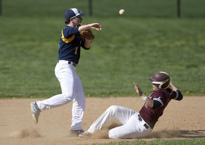 Catonsville's Matt Moulthrop turns a double play as Towson's Andrew Decker slides into second during the Comets' 3-2 win in 10 innings on Tuesday. Towson hosts Sparrows Point today and the Comets host Eastern Tech on Thursday.