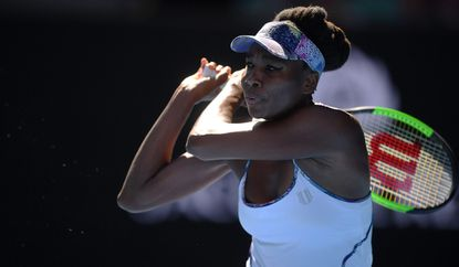 Venus Williams in action against Coco Vandeweghe during the women's singles semifinal match at the Australian Open Thursday.