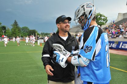 Ohio Machine head coach Bear Davis talks with Logan Schuss before the start of the game against the Boston Cannons on June 29, 2013 at Selby Stadium in Delaware, Ohio.