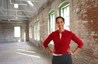China Boak Terrell, CEO of the American Communities Trust, stands in one of the recently renovated buildings on the Baltimore Food Hub campus on Oliver Street.