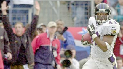 Anthony Mitchell returns a blocked punt for a touchdown during the fourth quarter of the Ravens' 24-10 win over the Tennessee Titans in the AFC divisional-round playoff game in Nashville on Sunday, Jan. 7, 2001.