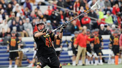 Maryland defenseman Bryce Young, pictured taking a shot against Navy in the 2017 season opener, made his first start of 2018 against Penn on Wednesday after missing the first three games.