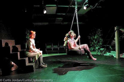 """Amy Belschner Rhodes and Deborah Randall (on swing) in a scene from """"Garbage Kids,"""" a journey through homelessness through the eyes of abandoned children."""