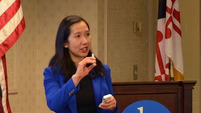 Baltimore Health Commissioner Dr. Leana Wen demonstrates how to administer naloxone, the drug used to reverse opioid overdoses. Wen urged business leaders at a breakfast sponsored by the Greater Baltimore Committee to have their employees trained to administer the drug.