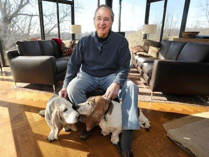Stanley Mazaroff and his Bassett hounds, on right, Harley and, left, Chloe, in his restored farmhouse.