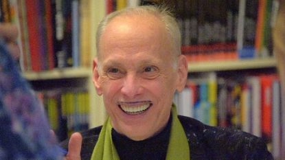 """John Waters smiles while chatting with fans during an appearance and book signing of his latest work, """"Make Trouble,"""" at Atomic Books. Hundreds of Waters fans spent three days at Camp John Waters in Connecticut in September"""