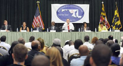 "From left: Joseph ""Jody"" T. Landers III (D); Vicki Ann Harding (R); Frank M. Conaway (D); Otis Rolley (D); moderator C. David Ward, MDF Chairperson; Mayor Stephanie Rawlings-Blake (D); and Sen. Catherine E. Pugh in a mayoral candidates debate that was held at the National Federation of the Blind."