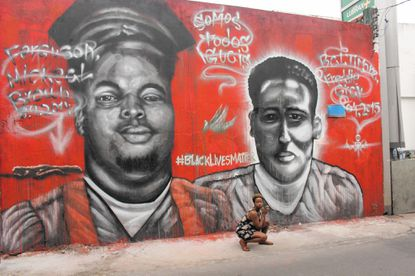 The Freddie Gray and Michael Brown mural in Brazil.
