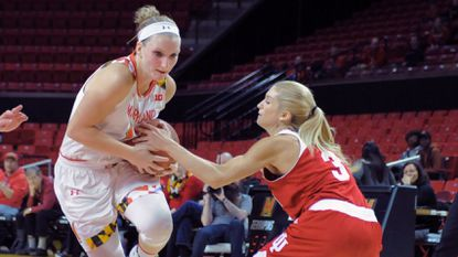 Maryland senior shooting guard Kristen Confroy, left, drives against Indiana's Tyra Buss in the second half of the Terps' 74-70 win Jan. 16. Confroy leads the Big Ten in 3-point shooting percentage at .456.