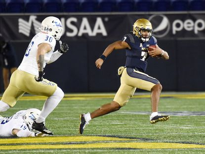 """Xavier Arline, pictured against Tulsa on Dec. 5, enters Navy spring football practice atop the depth chart at quarterback and """"will get every opportunity"""" to win the starting job."""