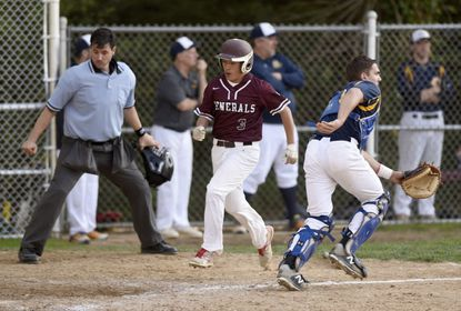 Towson High's Robert Brino runs past Catonsville catcher Kevin Deitz to score a run in the Generals' 3-2 loss in 10 innings last month.