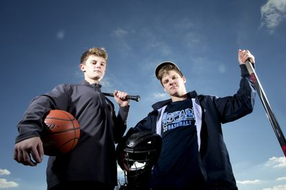 """Howard High School's Timmy Jakubek, left, plays baseball and basketball, while his brother, Brian, plays baseball and hockey.<span class=""""Apple-converted-space""""> </span>Their father, Chris, has encouraged the boys and their older sister, not pictured, to play multiple sports from a young age."""