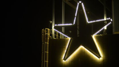 "The ""Star of Bethlehem,"" which once graced the Sparrows Point steel mill's 320-foot-tall L Blast furnace, is lit on a water treatment plan Nov. 30, 2016, as Tradepoint Atlantic continues a holiday tradition. It will be moved to the property's water tower this year."