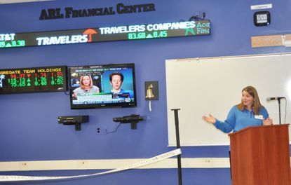Howard County Public Schools Superintendent Renee Foose introduces the ARL Financial Center stock ticker on Friday, March 20, 2014.