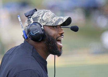 McDaniel's new coach, Demarcus White, talks with the team during the College football 2019 season opener against Misiericordia, in Westminster.