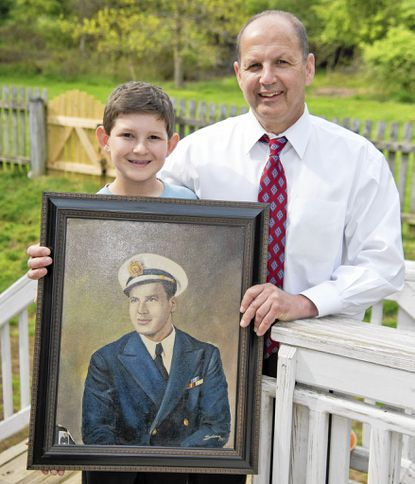 Murray Blum, right, and his 12-year-old son Jordan will travel to Cambridge England around Memorial Day to witness the dedication of the Cambridge American Cemetery visitors center, where an exhibit honors the heroic deeds of Merchant Marine Lt. Murray Blum, who died trying to save another solder's life in World War II.