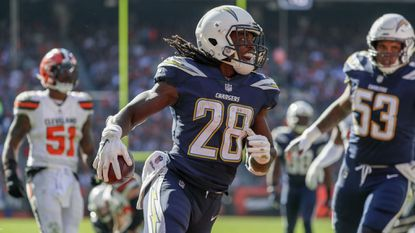 Injured Charger Melvin Gordon hopes he can get back in the running against Seattle