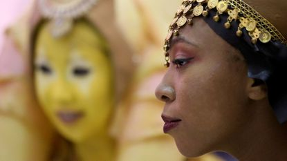 Tricia Pathy (left), of Toronto, dressed as a Togruta, and Bethany Jones, of San Diego, dressed as a Twi'lek, attend Star Wars Celebration at McCormick Place Friday.