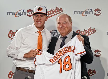 Then-Orioles' director of scouting Gary Rajsich with pitcher Grayson Rodriguez in 2018.