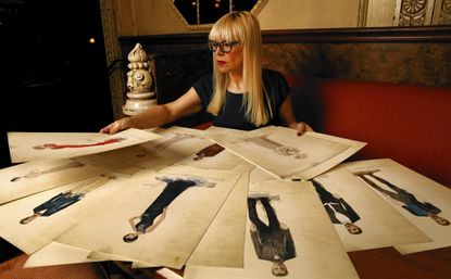"""Catherine Martin, costume designer for """"The Great Gatsby,"""" looks at original costume sketches for the film at the Chateau Marmont. She has earned two Academy Awards, for art direction and costume design on """"Moulin Rouge!"""""""