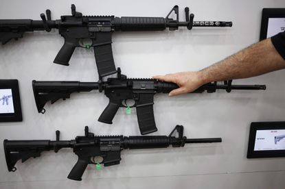 AR-15 rifles are displayed on the exhibit floor during the National Rifle Association (NRA) annual meeting in Louisville, Kentucky, on May 20, 2016.
