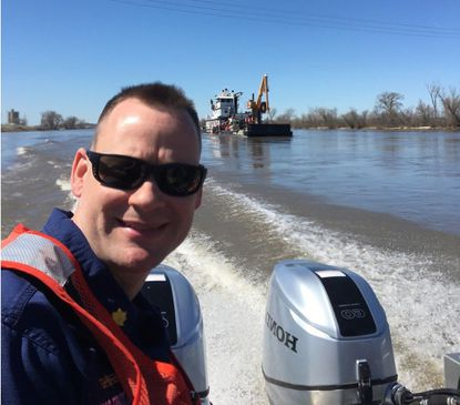 Christian Barger departs Coast Guard Cutter Gasconade on April 8, 2020, in Omaha, Nebraska, after conducting a readiness inspection prior to their departure for the first ATON service run on the Missouri River. - Original Credit: Courtesy photo