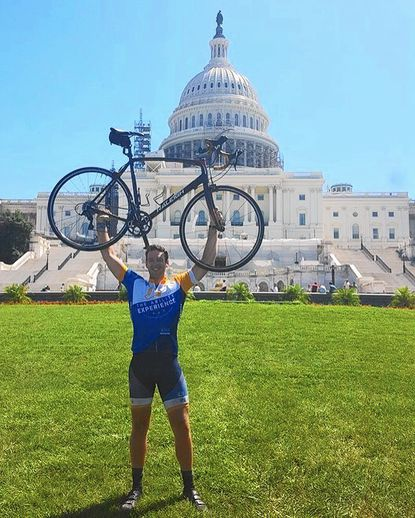 Peter Herrick arrives in Washington, D.C., after riding his bike from coast to coast