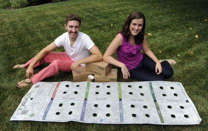 Chad Erbe, left, and Maria Louzon, right, are managers in the Earth Starter company.