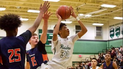 Boys basketball roundup: Atholton moves into sole possession of first place