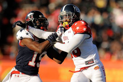 Jimmie Ward (left) defends Lavelle Westbrooks during the Senior Bowl.